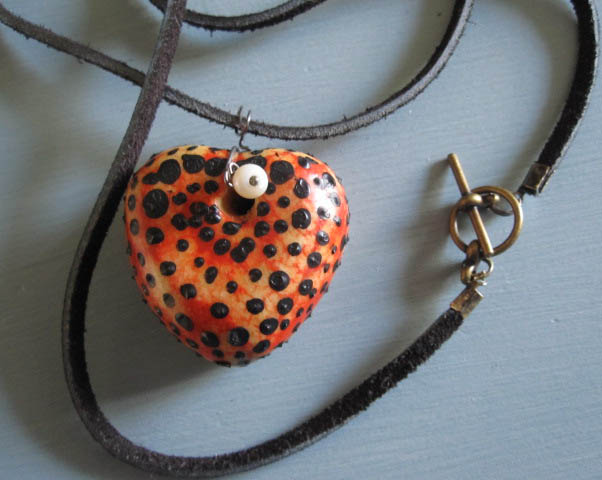 heart, thong and dull brass clasp